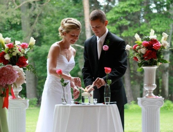 Above The Wedding Ceremony Flower Arrangements For This Outdoor Look Stunning On White Pillars Contain Red