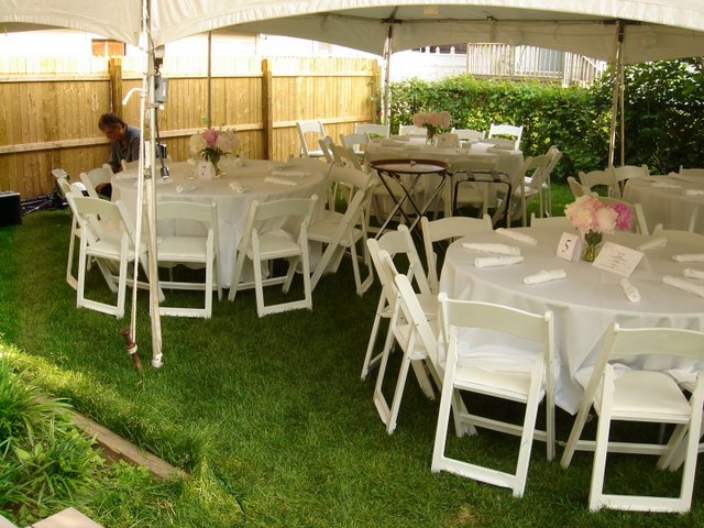 outdoor wedding with peony table centerpieces